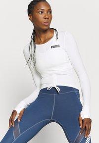 Puma - PAMELA REIF X PUMA COLLECTION RUSHING - Sports shirt - star white - 3