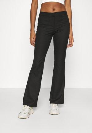 RITZA SKINNY FLARED TROUSER - Pantalon classique - black