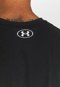 Under Armour - ROCK BRAHMA BULL - Print T-shirt - black/offwhite - 6