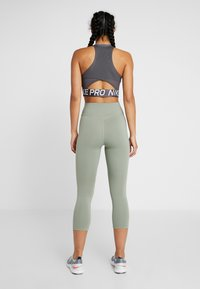 Nike Performance - NIKE ONE TIGHT CAPRI - Leggings - jade stone/black - 2