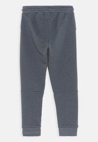 Hummel - OCHO PANTS UNISEX - Teplákové kalhoty - ombre blue - 1