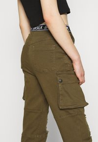 SIKSILK - DISTRESSED - Tracksuit bottoms - khaki - 3