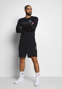 Jack & Jones - JJIZPOLYESTER SHORT - Sports shorts - black - 1