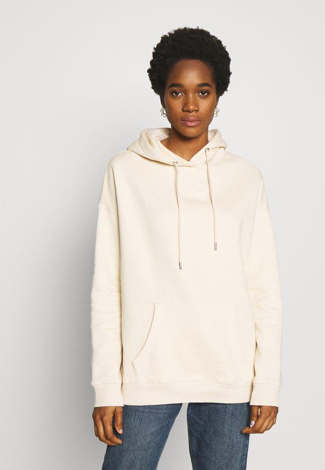 OVERSIZED HOODIE - Jersey con capucha - beige