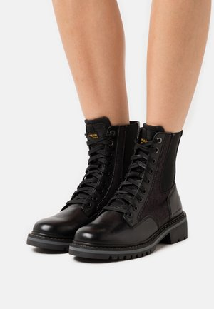 CORE BOOT II - Lace-up ankle boots - black