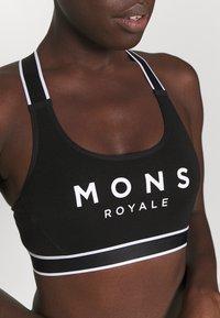 Mons Royale - STELLA X BACK BRA - Sportovní podprsenky s lehkou oporou - black - 6