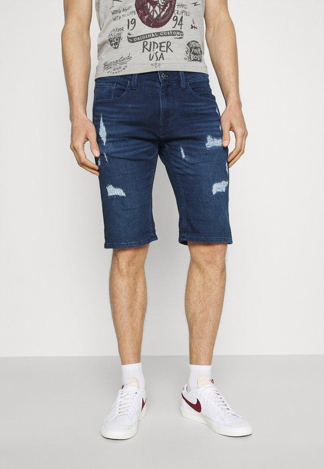 COMMERCIAL KEN HOLES - Denim shorts - blue