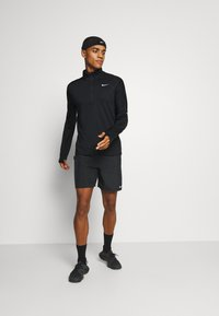 Nike Performance - Sportshirt - black/silver - 1