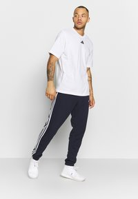 adidas Performance - ESSENTIALS 3STRIPES FRENCH TERRY SPORT PANTS - Jogginghose - navy - 1