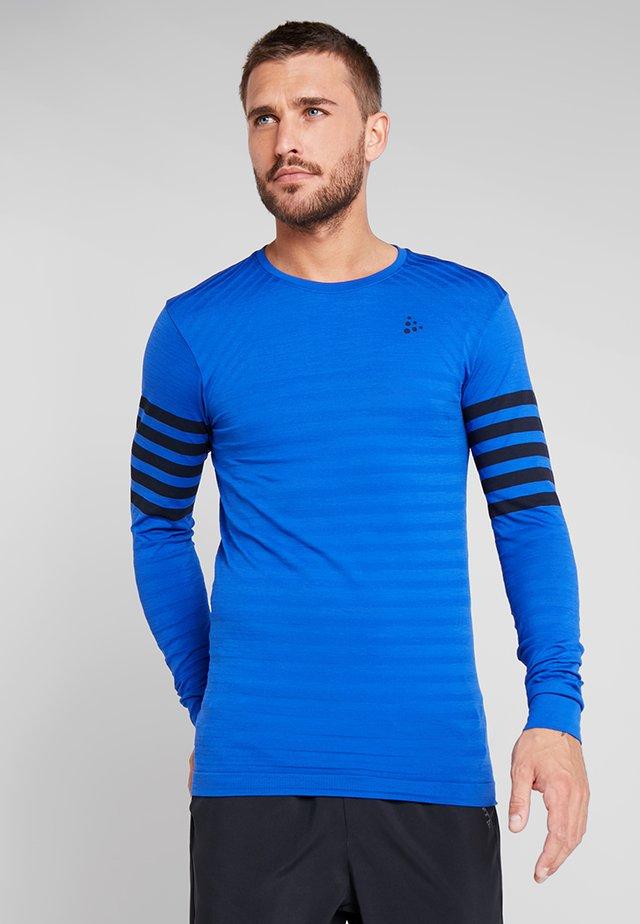 DRY FUSEKNIT BLOCKED - Sports shirt - burst/blaze