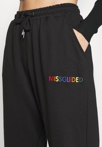 Missguided Petite - PRIDE JOGGERS - Tracksuit bottoms - black - 4