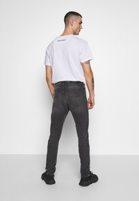 Tiger of Sweden - EVOLVE - Jean slim - black - 2