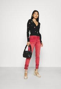 Desigual - PANT DELFOS - Slim fit jeans - red - 1