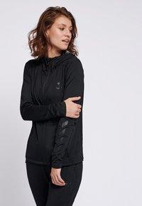 Hummel - SELBY  - Zip-up hoodie - black - 0