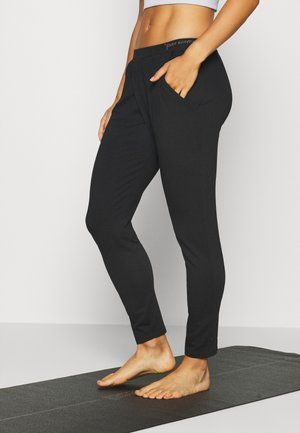 MOKSHA - Tracksuit bottoms - deep black