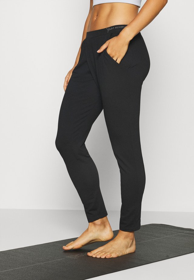 MOKSHA - Pantalon de survêtement - deep black