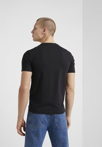 EA7 Emporio Armani - SIDE TAPE - Print T-shirt - black
