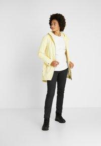 Didriksons - FOLKA WOMEN'S - Waterproof jacket - light yellow - 1