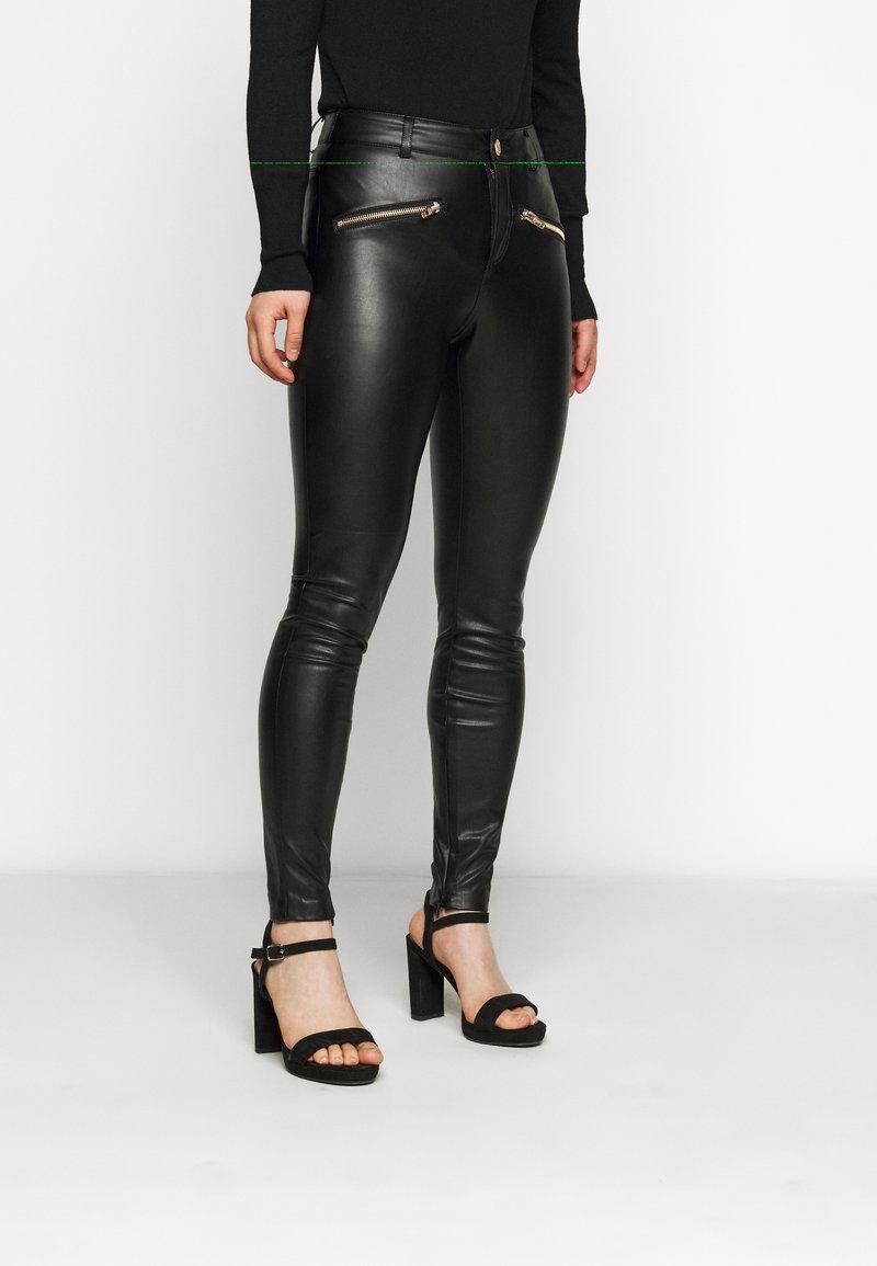 ONLY Petite - ONLHENRIETTA - Trousers - black