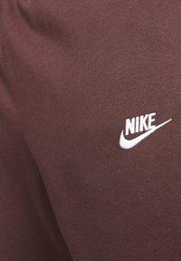 Nike Sportswear - CLUB - Tracksuit bottoms - bordeaux - 3