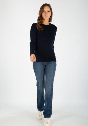 CARAVELLE - Straight leg jeans - stone