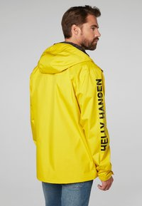 Helly Hansen - ERVIK  - Waterproof jacket - yellow - 1