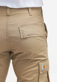 Carhartt WIP - REGULAR COLUMBIA - Pantalon cargo - leather rinsed
