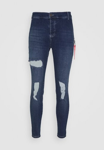 DISTRESSED  WITH ZIP DETAIL