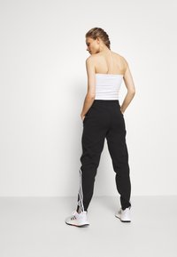adidas Performance - PANT - Pantalon de survêtement - black/white - 2