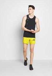 Nike Performance - DRY MILER TANK TECH - Sports shirt - black/lemon - 1