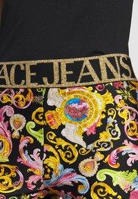 Versace Jeans Couture - LADY FUSEAUX - Legginsy - black - 4