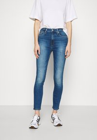 Calvin Klein Jeans - HIGH RISE SUPER SKINNY ANKLE - Jeans Skinny Fit - bright blue - 0