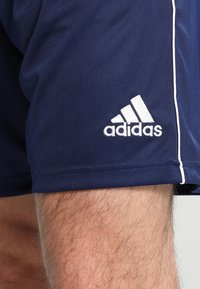 adidas Performance - CORE ELEVEN PRIMEGREEN FOOTBALL 1/4 SHORTS - Krótkie spodenki sportowe - dark blue/white - 4