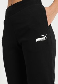Puma - Tracksuit bottoms - cotton black
