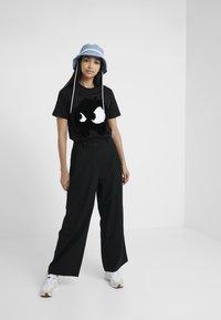 McQ Alexander McQueen - LOOSE PANTS - Trousers - black - 1