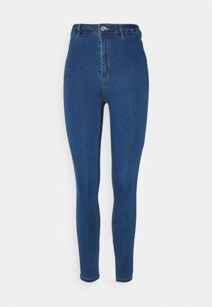 COATED SPLIT VICE - Trousers - blue