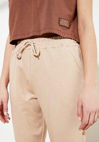 Trendyol - Tracksuit bottoms - brown - 4
