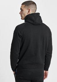Hummel - HMLSCORPIUS  - Zip-up hoodie - black - 2