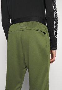 adidas Performance - TECH PANT - Tracksuit bottoms - wild pine - 5