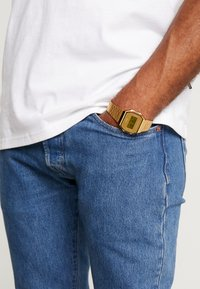 Casio - Digital watch - gold-coloured - 0