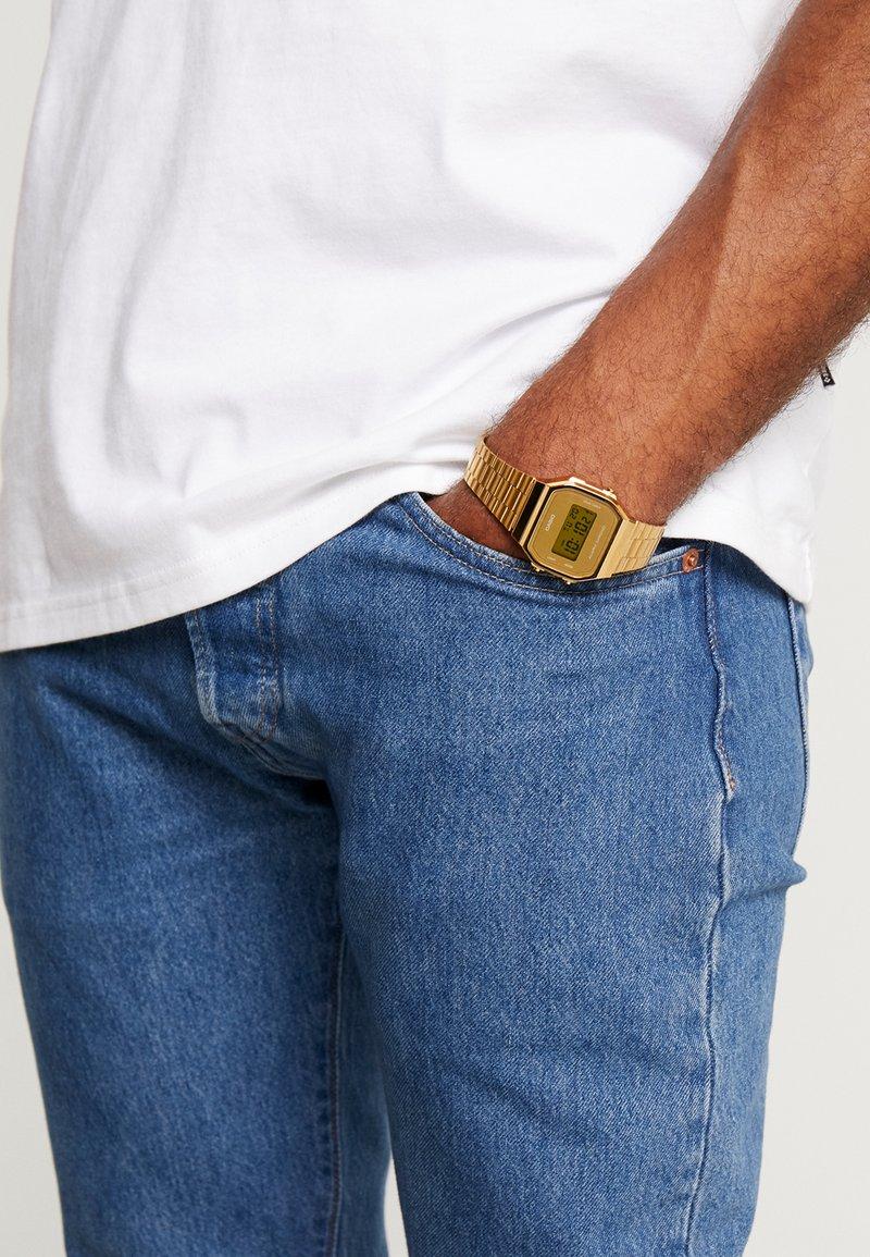 Casio - Digital watch - gold-coloured