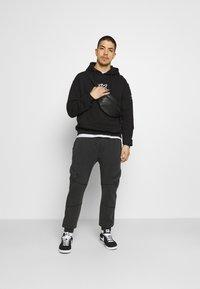FUBU - SCRIPT HOODED - Sweatshirt - black - 1