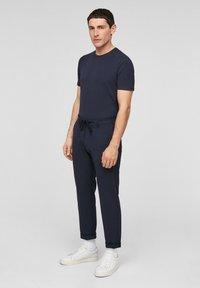 s.Oliver BLACK LABEL - SLIM FIT - Tracksuit bottoms - dark blue - 1