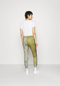 Replay - PANTS - Tracksuit bottoms - red/green/multicolor - 2