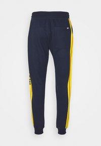 Tommy Jeans - Tracksuit bottoms - twilight navy - 1