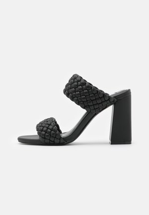 TANGLE - Heeled mules - black