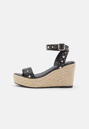 Korkeakorkoiset sandaalit - noir