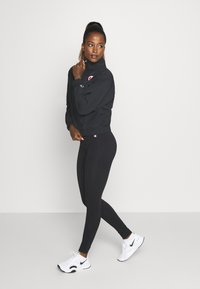 Champion - ESSENTIAL - Leggings - black - 1