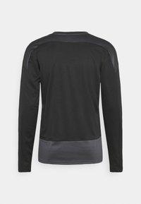 Puma - TEAMGOAL TRAINING  - Fleece jumper - black/asphalt - 6