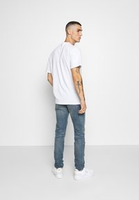 Levi's® - 512 SLIM TAPER  - Jeans Tapered Fit - yell and shout adapt - 2